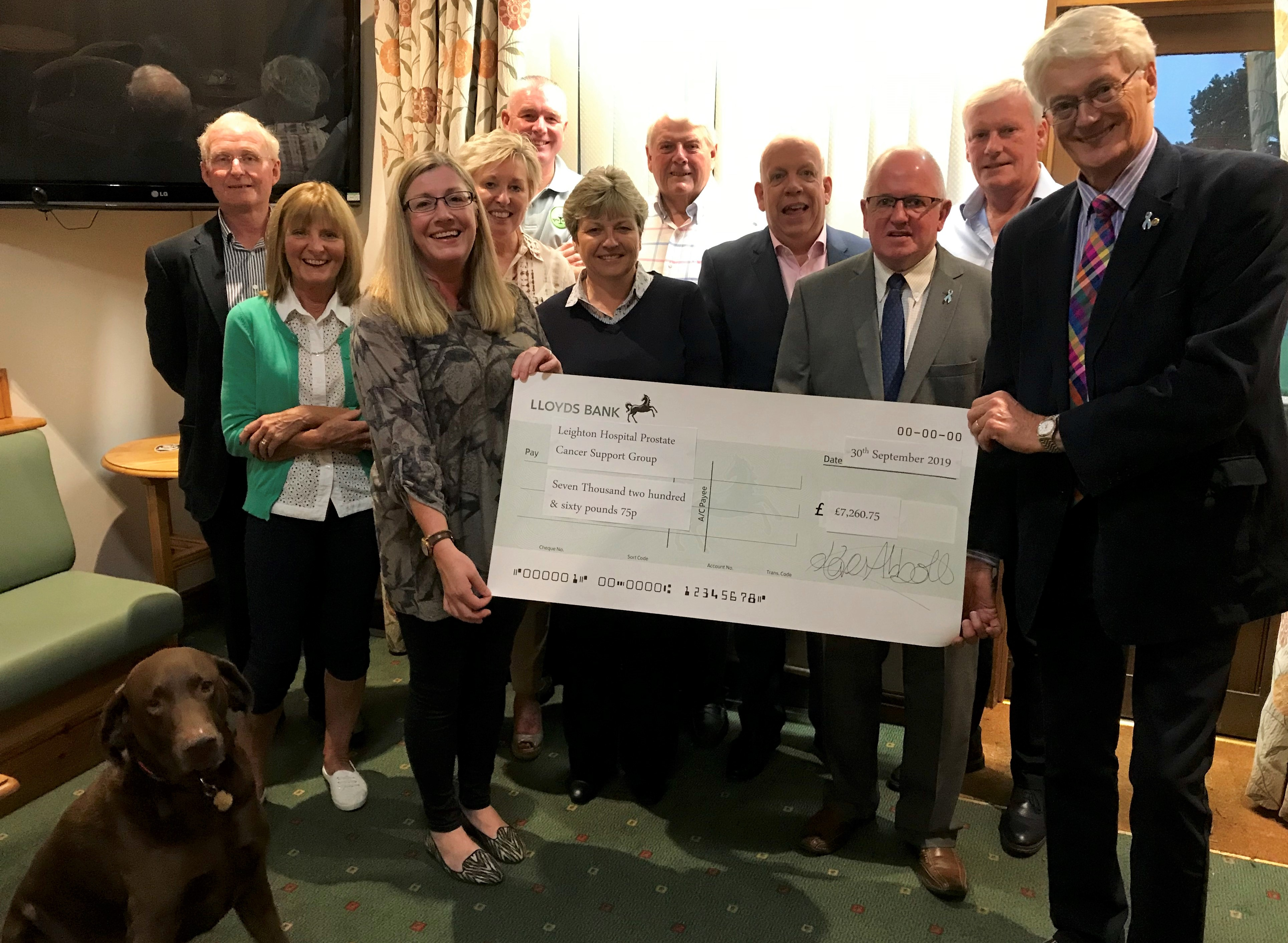 Eaton Golf Club's 19th Hole Charity Committee makes a huge donation to the Group